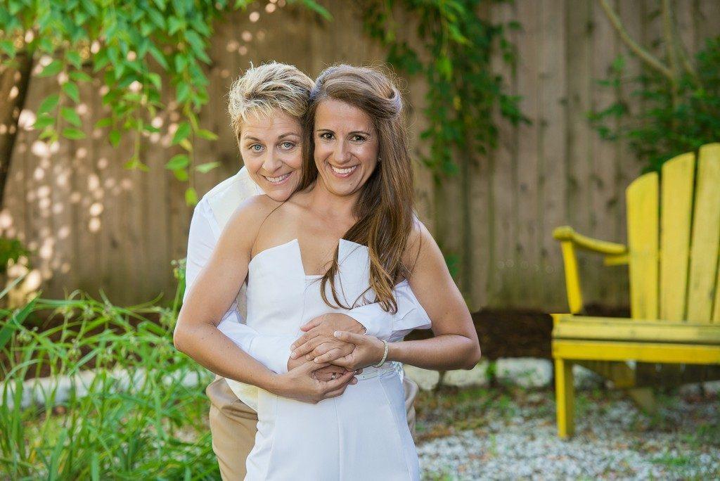 Happy wedding couple on backyard