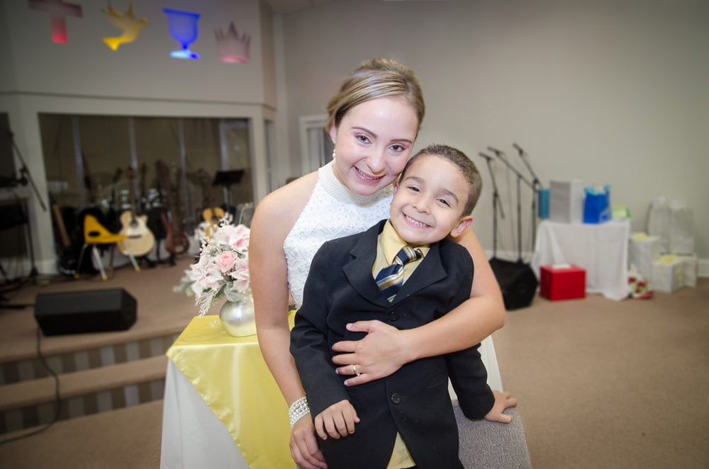 bride with nephew on wedding reception