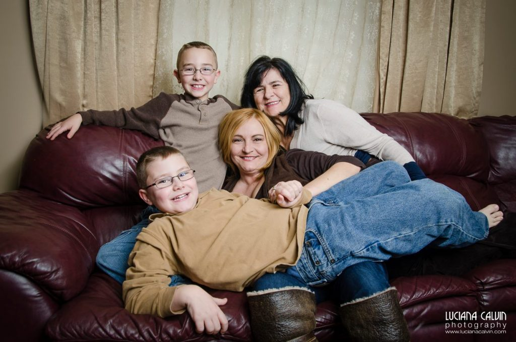 Family together on a couch for family photo