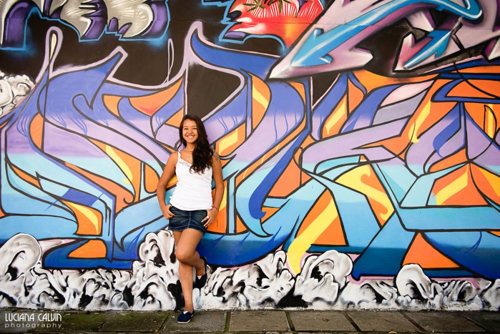 Teen on in front of a graffiti wall in Curitiba Brazil