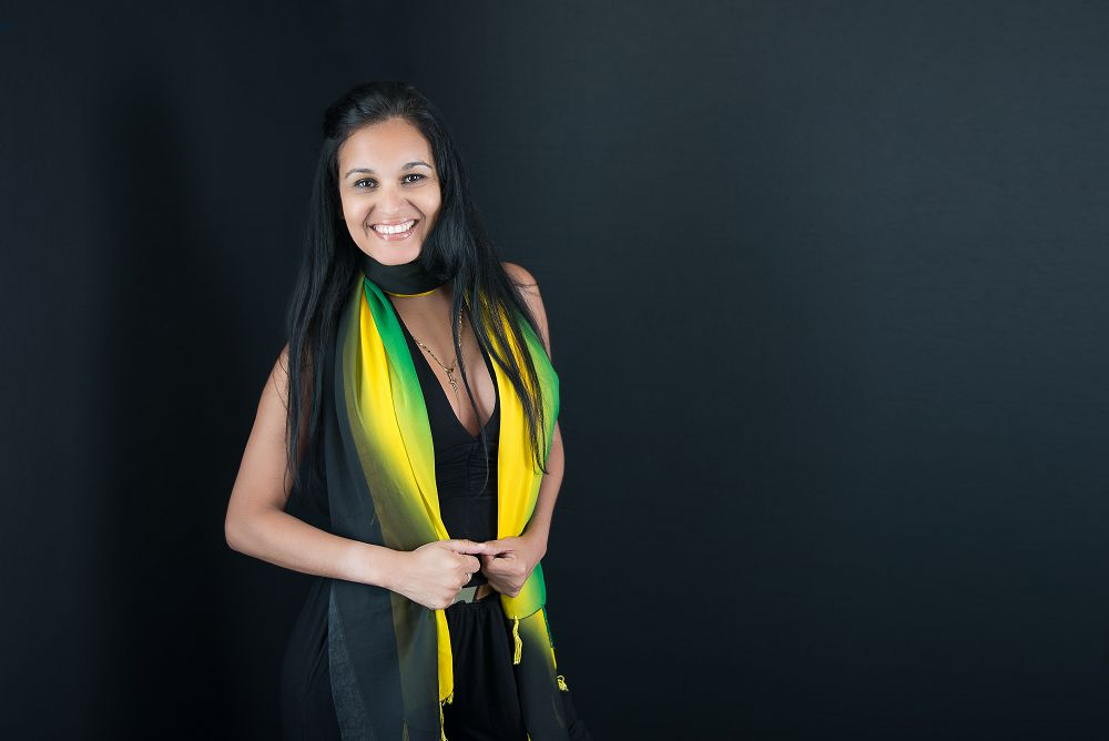 Young woman with green and yellow scarf