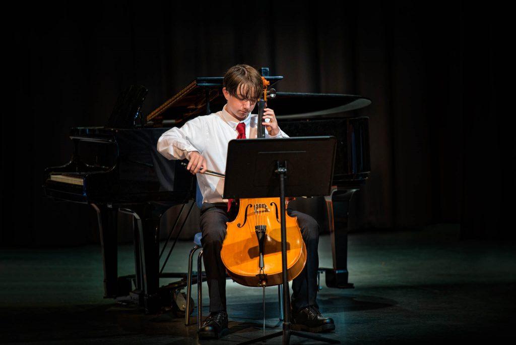 Teen playing cello