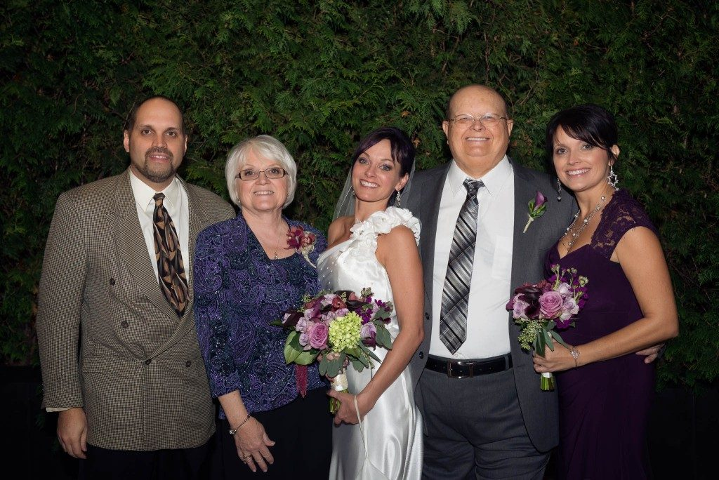 Wedding couple with family