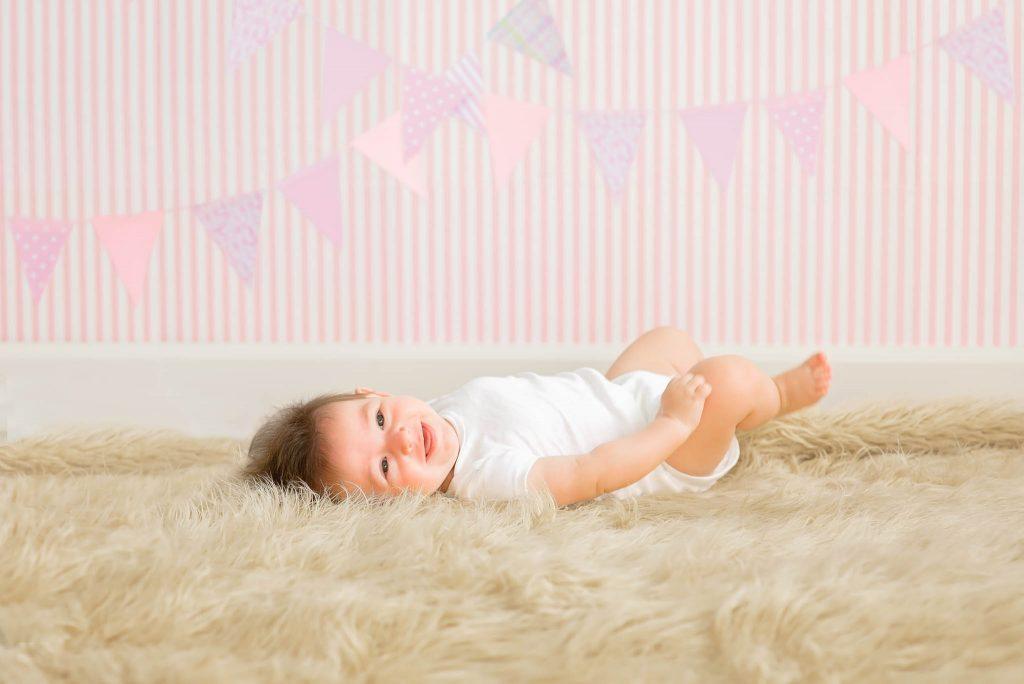 baby laying down on fur rug
