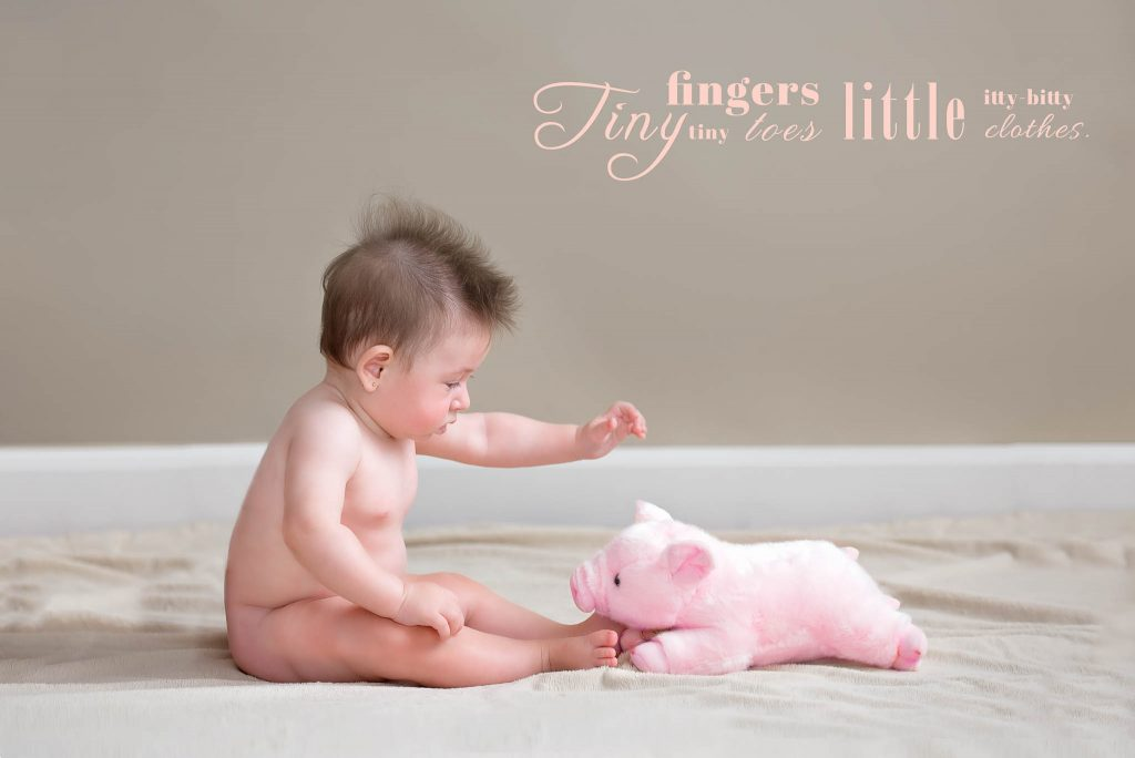 baby girl with pink pig