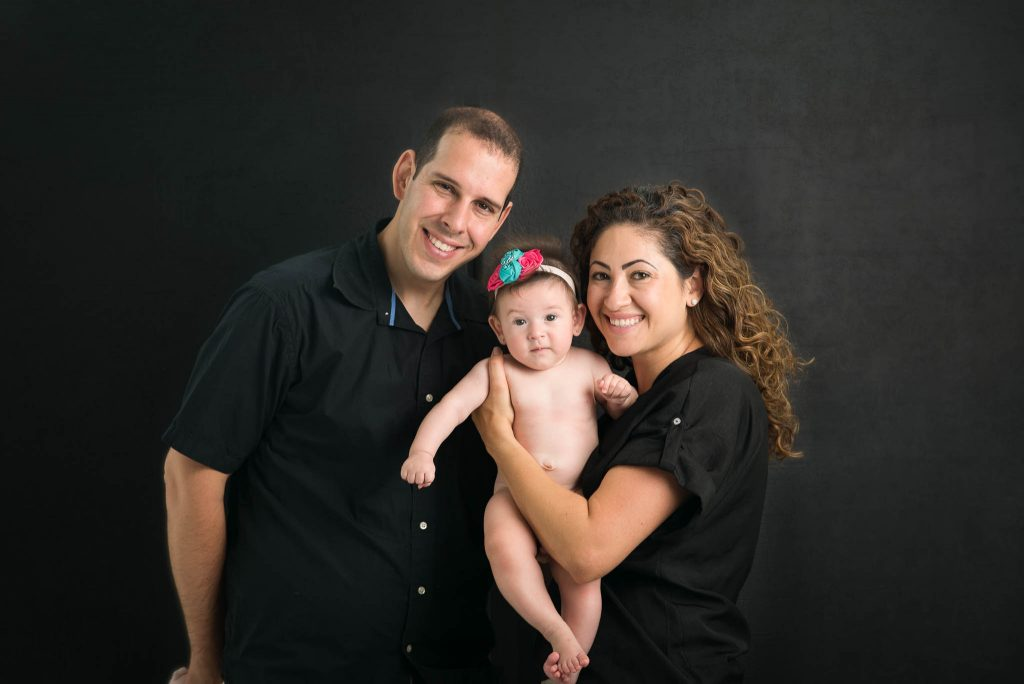baby girl with parents