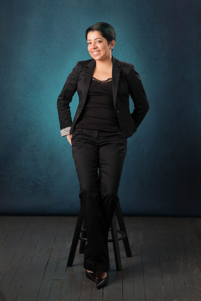 professional woman seating on a stool