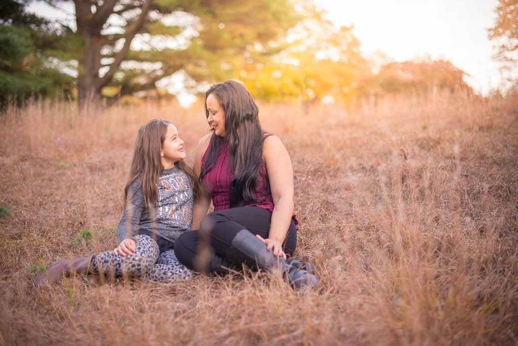 Mother and daughter portrait with sunray