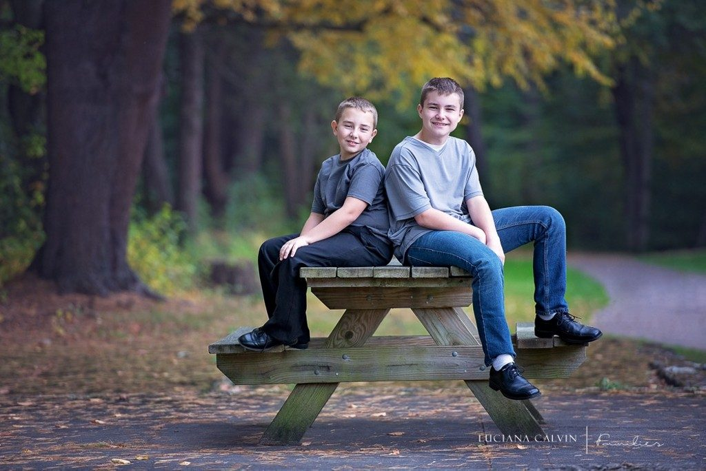 boys seating on a picnic bench at the park