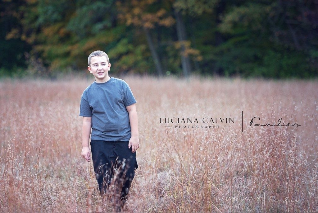 boy walking on the tall grass