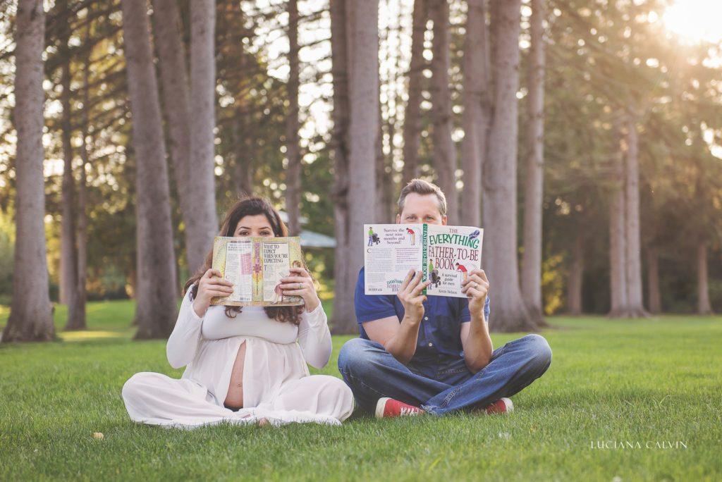 pregnant couple reading maternity books