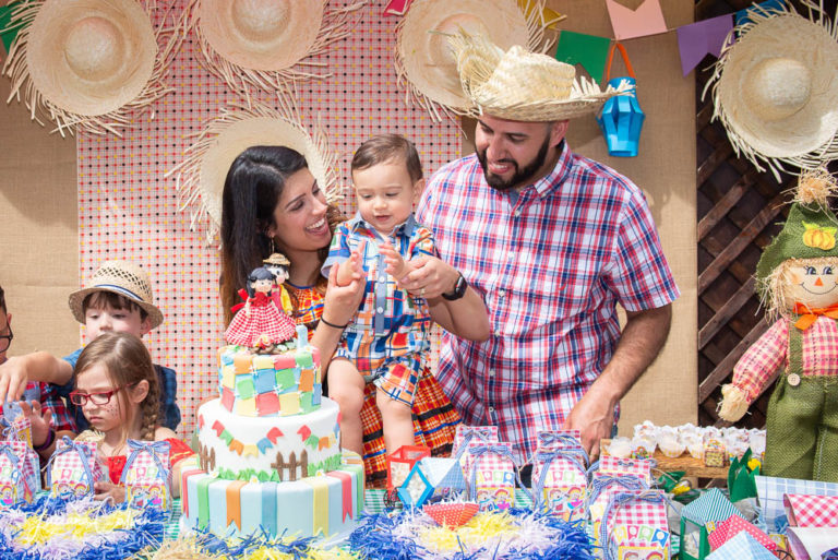 baby and parents singing happy birthday